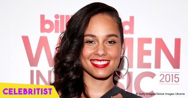 Alicia Keys flaunts curves in sunflower print swimsuit on beach in Aruba