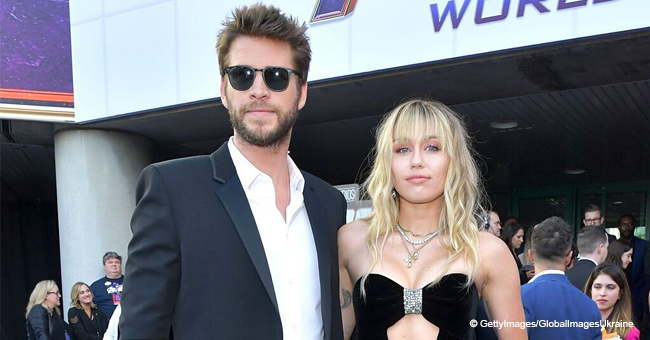 Miley Cyrus Flaunts Tattoos in Bespoke Velvet Dress with a Diamond-Shape Cut-Out