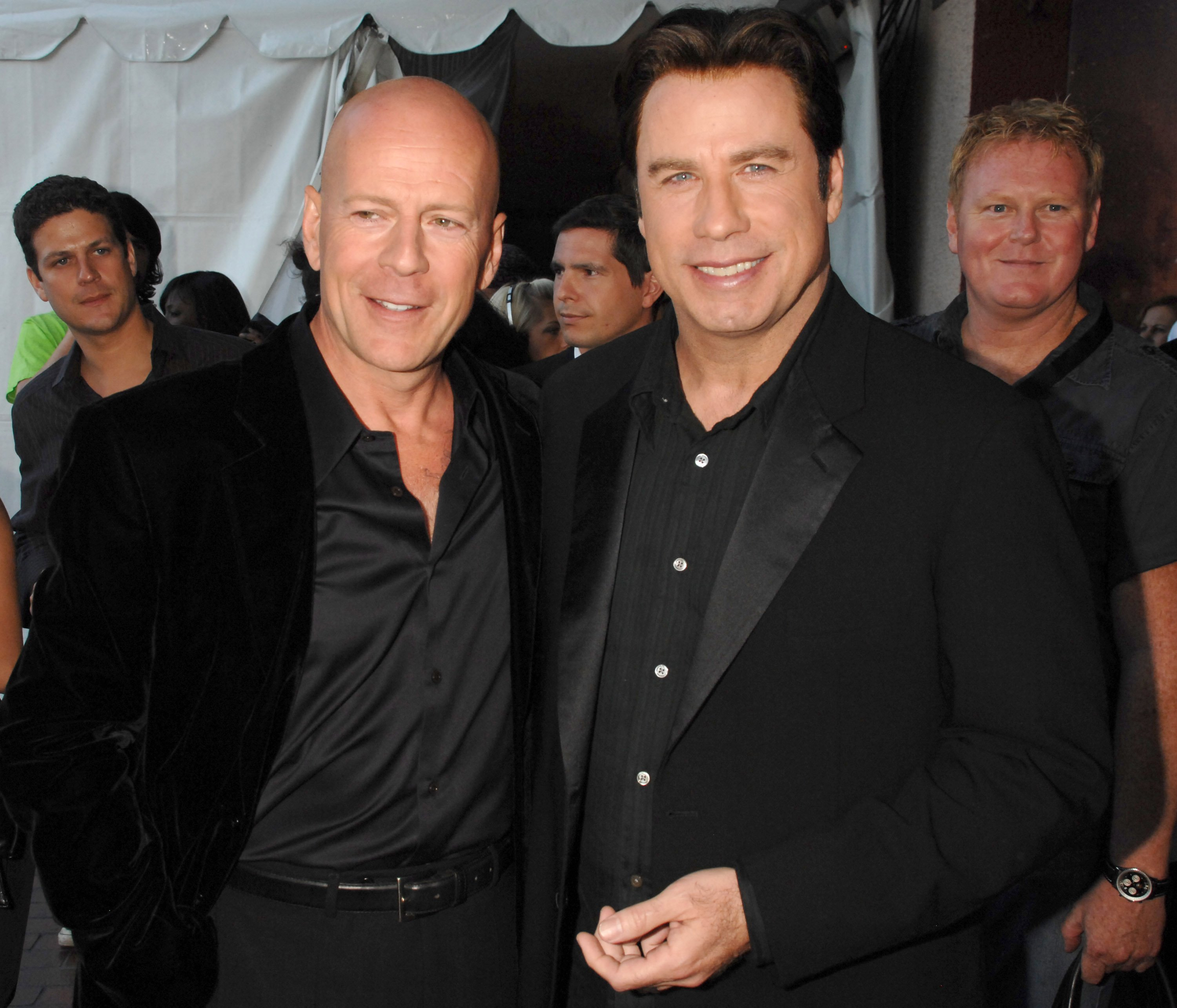 An undated image of Bruce Willis and John Travolta during 2007 MTV Movie Awards in Los Angeles, California | Photo: Getty Images
