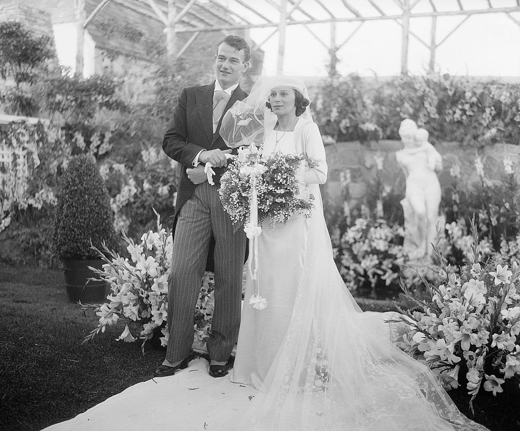 John Wayne and his bride Miss Josephine Saenz, daughter of Dr. Jose Saenz, Panamanian Counsul in Los Angeles, on June 28, 1933, in Los Angeles   Photo: Getty Images