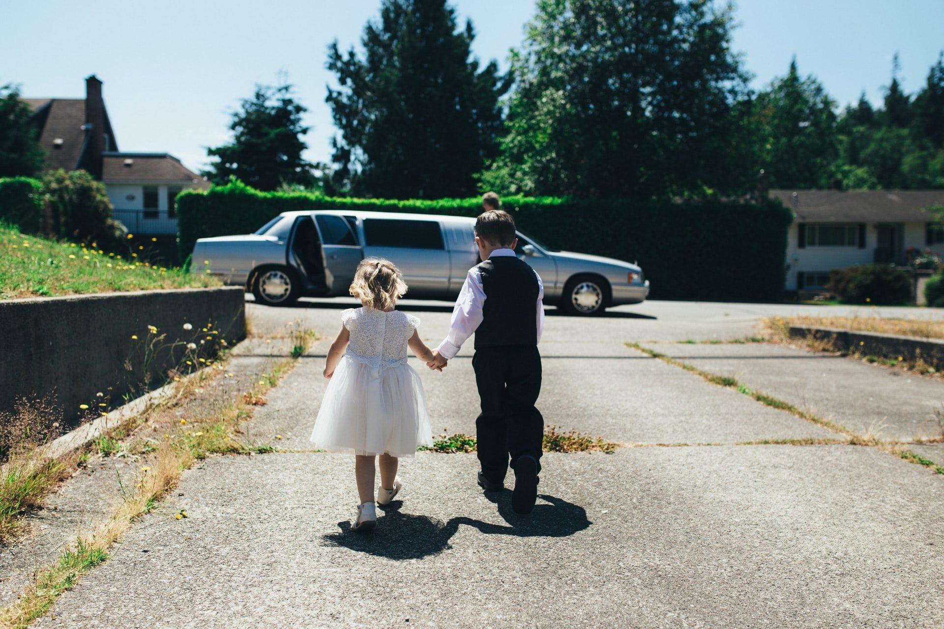 Boy and girl walking on the road   Source: Unsplash