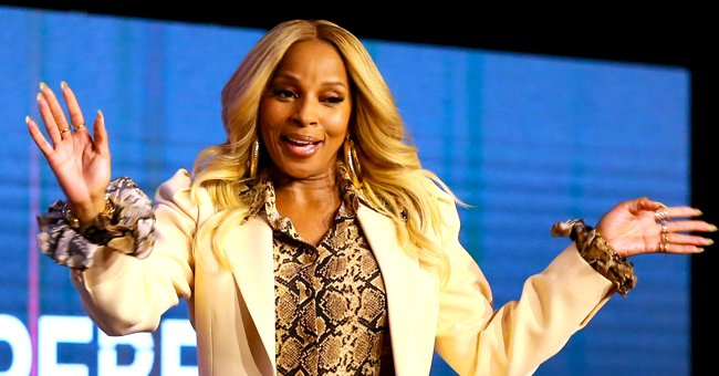 Mary J Blige Poses Glamorously in a Custom Gold Corset as Sea Waves Hit Her in a New Beach Photo