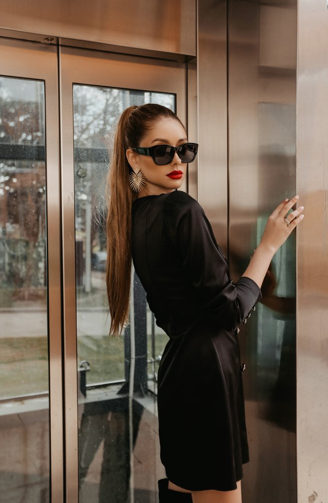 Model with sunglasses inside an elevator   Source: Shutterstock
