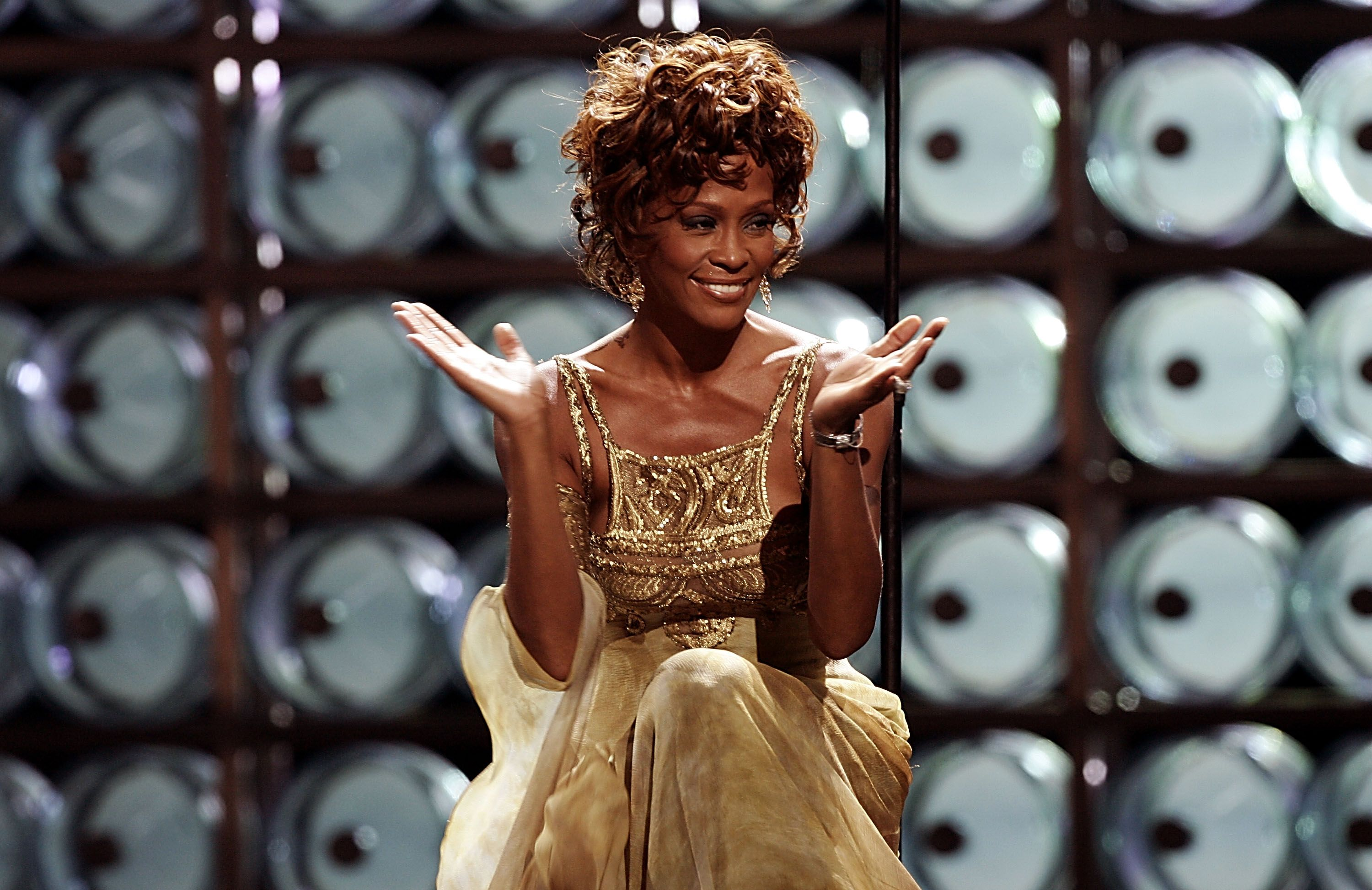 Whitney Houston is seen performing on stage during the 2004 World Music Awards. | Source: Getty Images