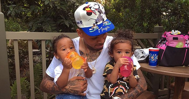 Check Out This Throwback Photo of Chris Brown Carrying Daughter Royalty and Omarion's Son Megaa