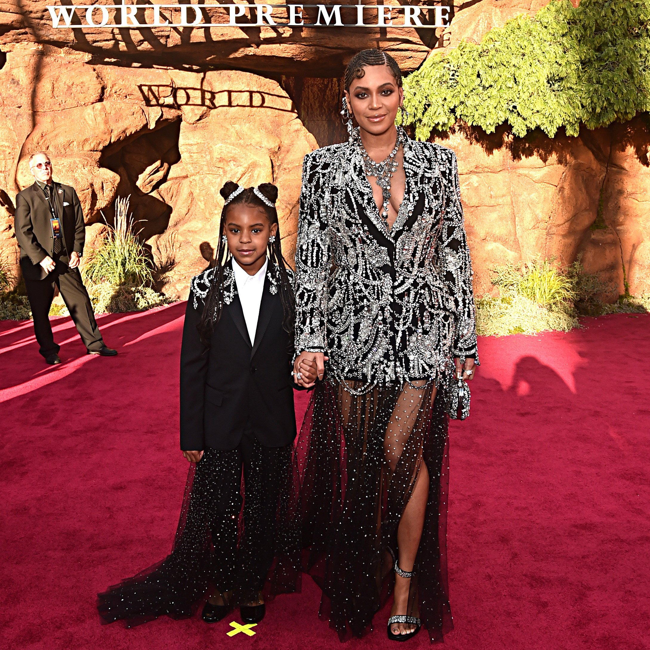 "Beyonce is escorted by her daughter, Blue Ivy Carter at the world premiere of ""The Lion King"" at the Dolby Theater in Hollywood on July 9, 2019. 