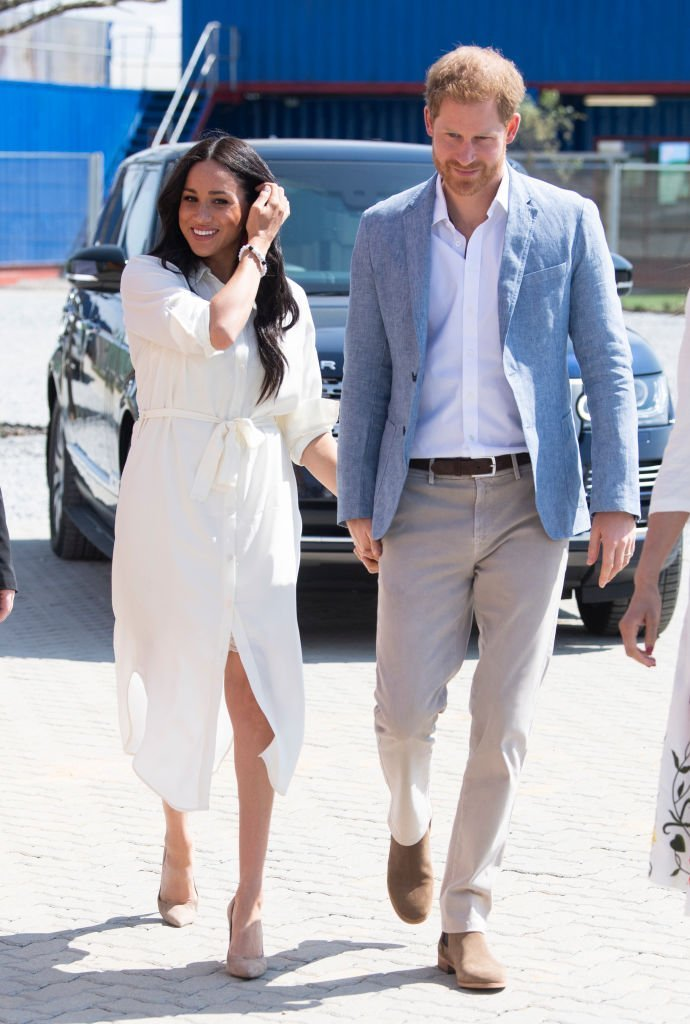 Prince Harry, Duke of Sussex and Meghan, Duchess of Sussex visit Tembisa township to learn about Youth Employment Services (YES)   Photo: Getty Images