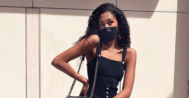 Aoki Lee Simmons Flaunts Her Enviable Figure & Slim Legs Posing In a Tight Black Dress