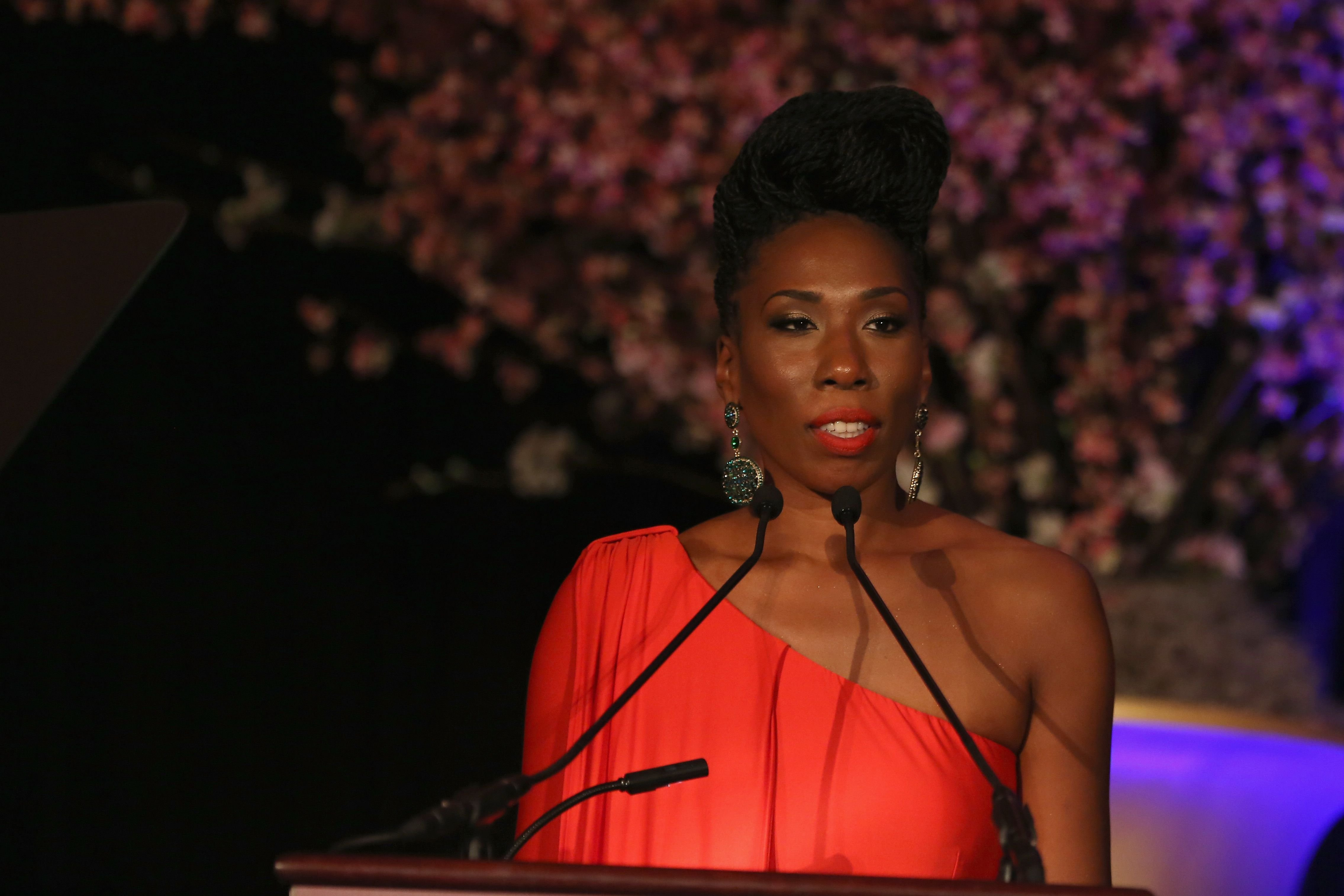 "Brandi Harvey stands behind a podium during her speech at the ""Steve & Marjorie Harvey Foundation Gala"" on May 3, 2014, in Chicago, Illinois 