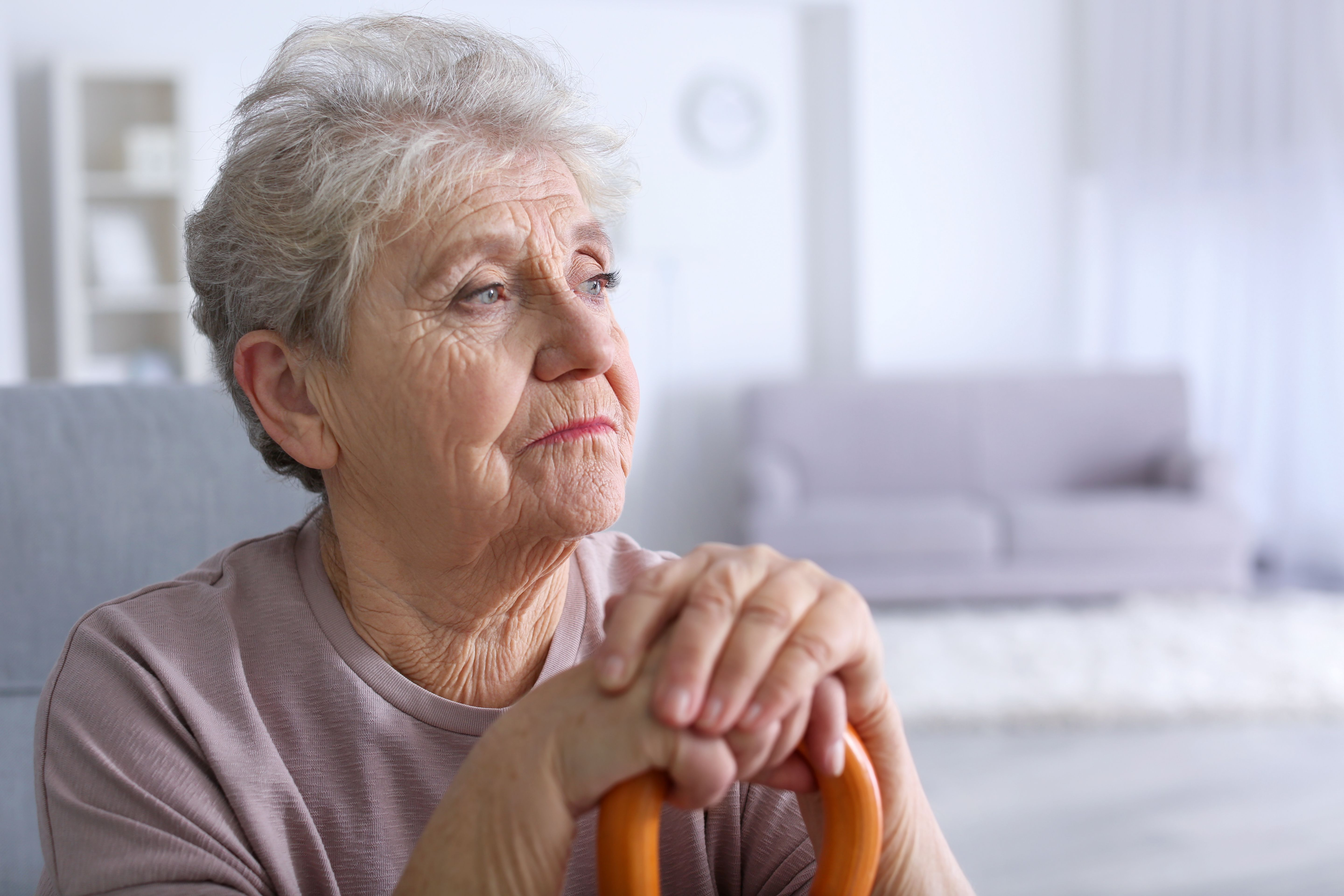 An elderly woman looks disappointed. | Source: Shutterstock