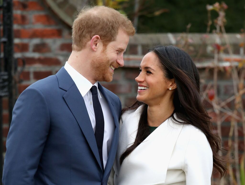 Prince Harry and Meghan Markle during an official photocall to announce their engagement at Kensington Palace on November 27, 2017 | Photo: Getty Images