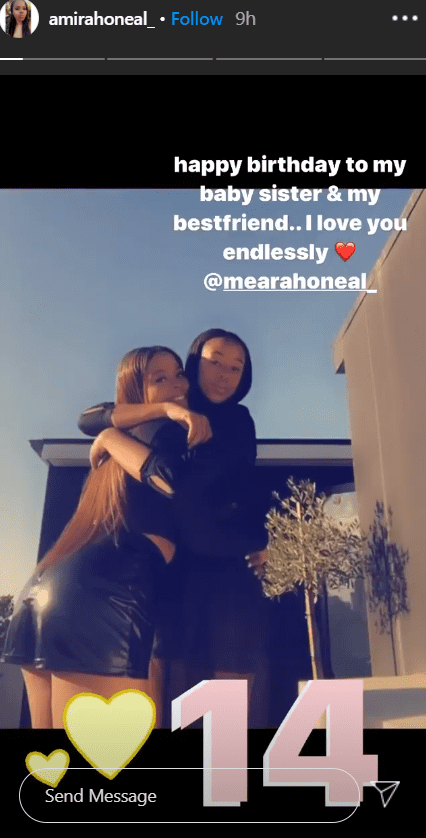 Mimi giving her sister Me'Arah a big hug as she wished her a happy 14th birthday | Photo: Instagram/amiraoneal_