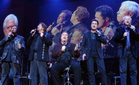 The Osmonds perform during their 50th anniversary tour at Wembley Arena in London, England | Photo: Getty Images