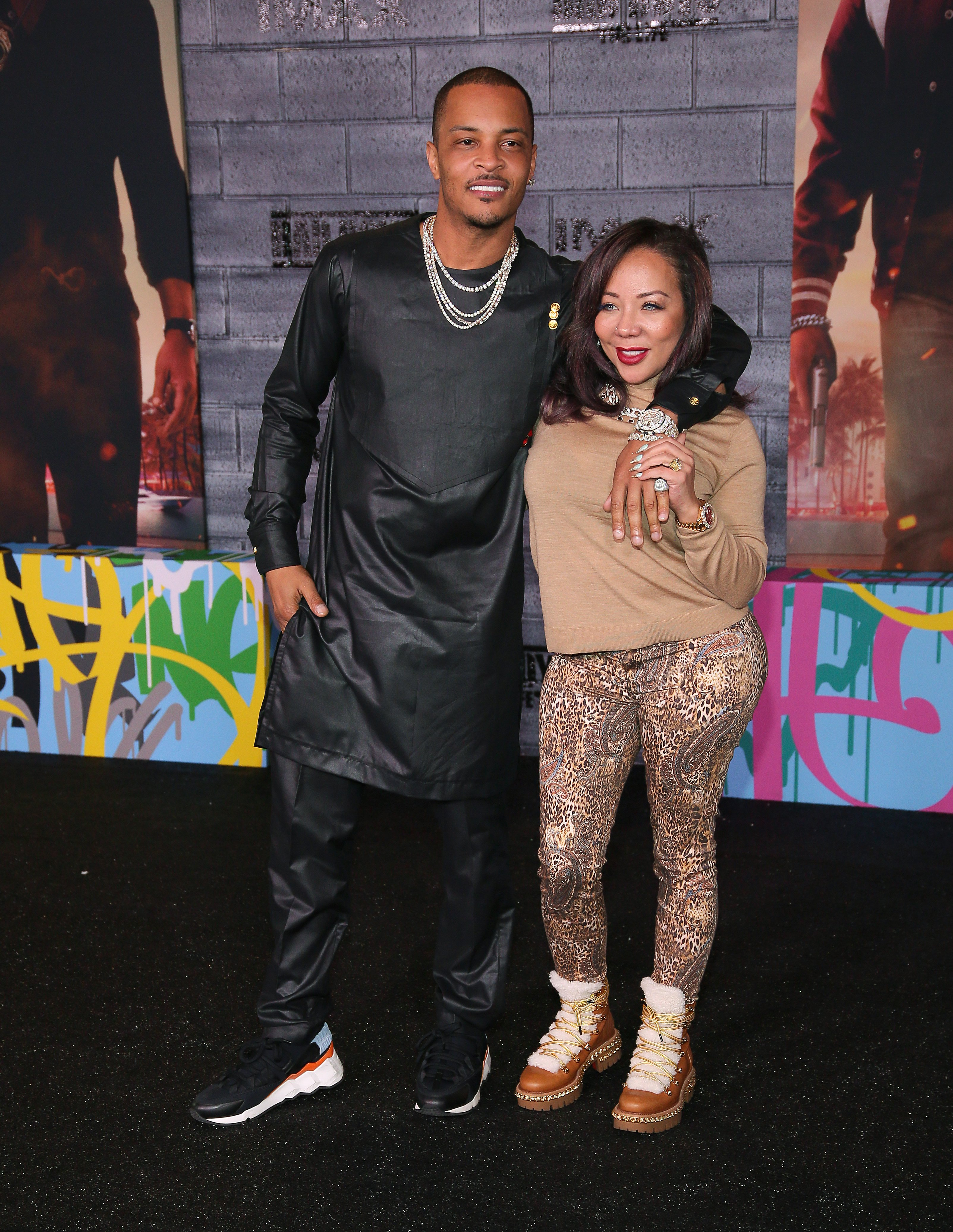 """T.I. and Tameka """"Tiny"""" Harris at the world premiere of """"Bad Boys for Life"""" on January 14, 2020 in Hollywood, California. 
