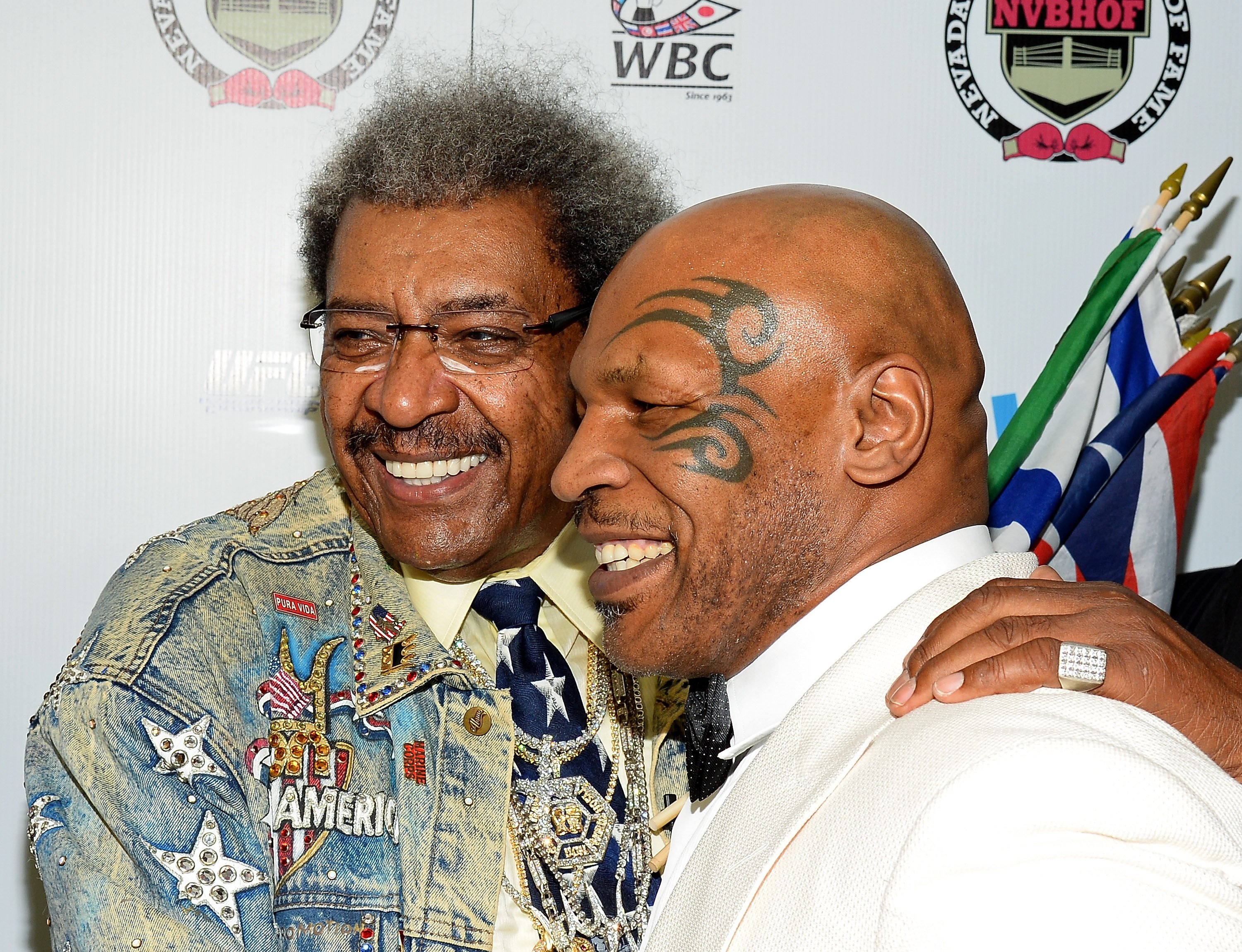 Boxing promoter and inductee Don King (L) and former boxer and inductee Mike Tyson arrive at the Nevada Boxing Hall of Fame inaugural induction gala. | Source: Getty Images