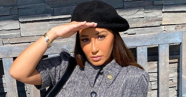 Adrienne Bailon of 'The Real' Puts Her Slimmer Curves on Display in Green Top & Fitting Shorts