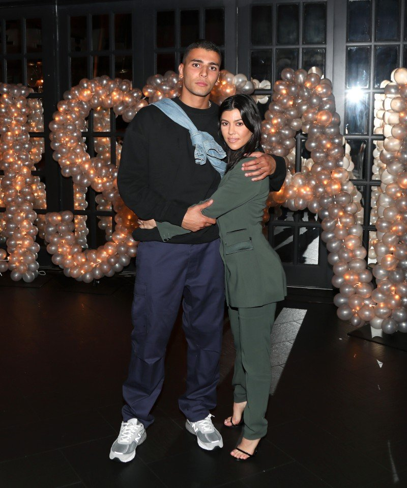 Younes Bendjima and Kourtney Kardashian posing for a photo on Tristan Thompson's birthday at Beauty & Essex, Los Angeles, California, in March 2018. | Image: Getty Images.