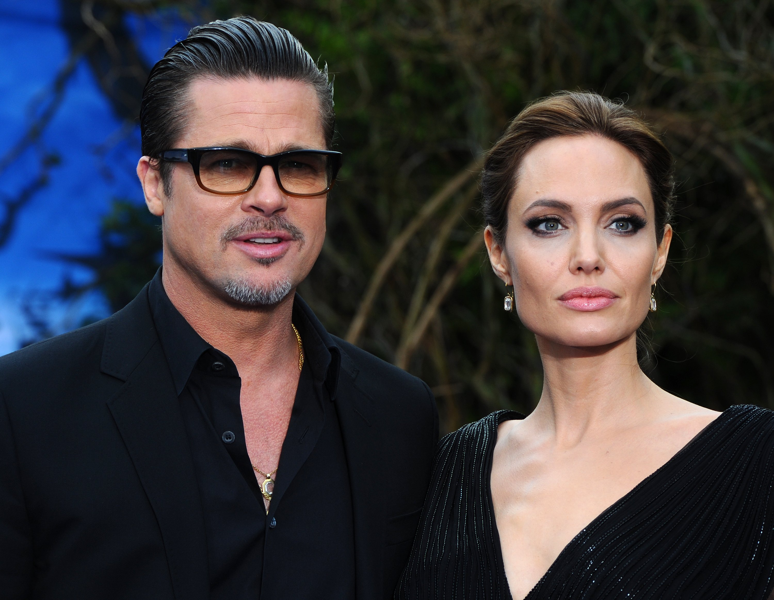 """Brad Pitt and Angelina Jolie attend a private reception as costumes and props from Disney's """"Maleficent"""" are exhibited in support of Great Ormond Street Hospital at Kensington Palace on May 8, 2014 in London, England. 