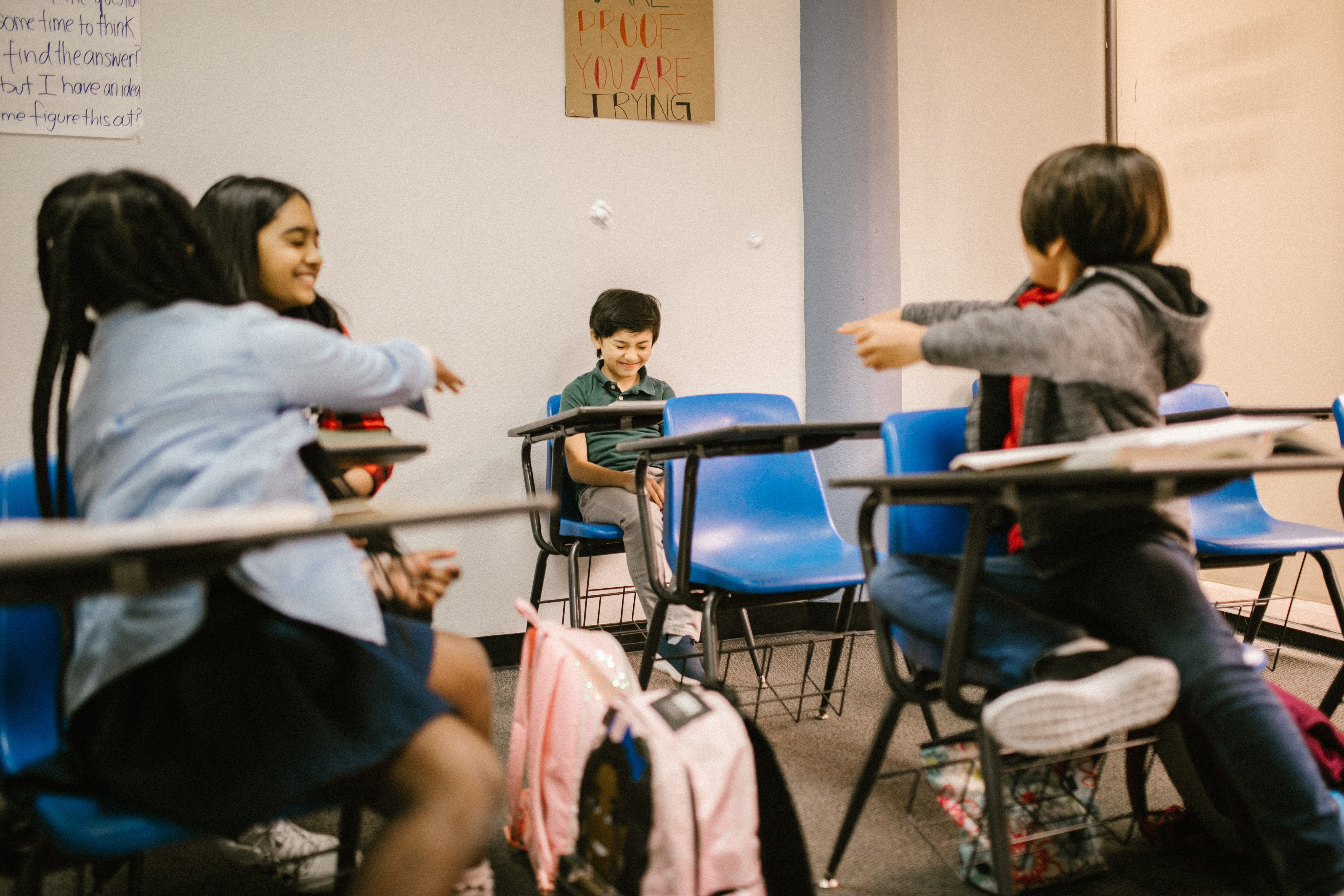 Boy getting bullied by his classmates   Photo: Pexels