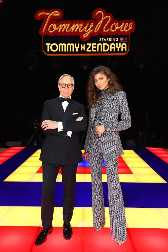 Designer Tommy Hilfiger and Zendaya pose on the runway during the Tommy Hilfiger TOMMYNOW Spring 2019 : TommyXZendaya Premieres at Theatre des Champs-Elysees. | Photo: Getty Images