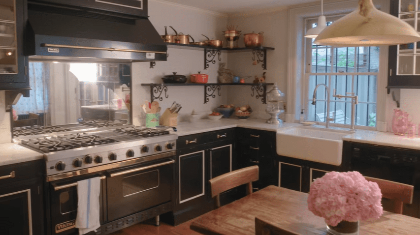 The kitchen has stainless steel |  Source: YouTube/Architectural Digest