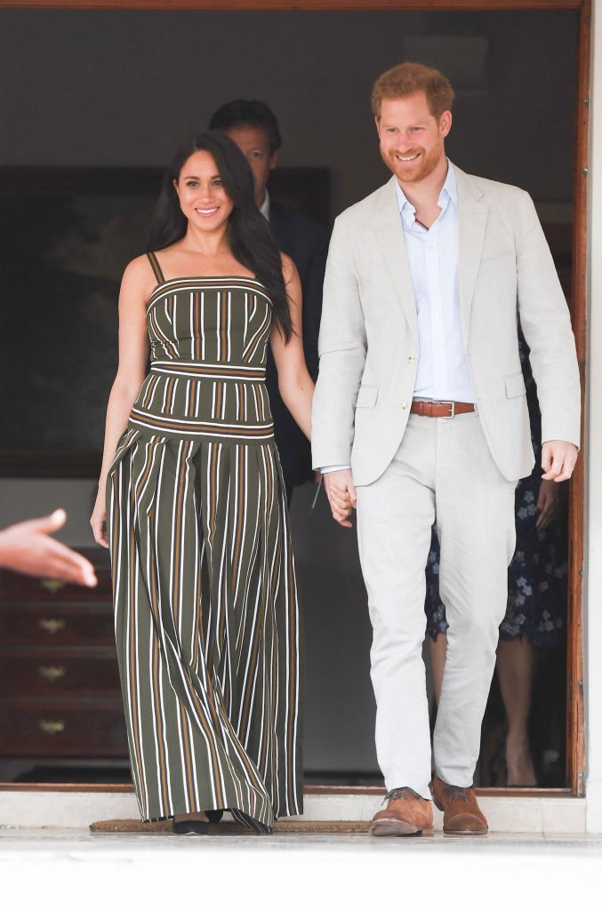 Prince Harry and Meghan attend a reception at the Residence of the British High Commissioner, during the royal tour of South Africa.| Source: Getty Images