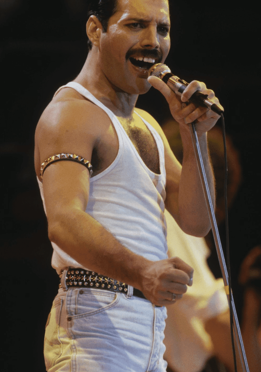 Singer Freddie Mercury of Queen performs during Live Aid at Wembley Stadium on 13 July 1985. | Source: Getty Images