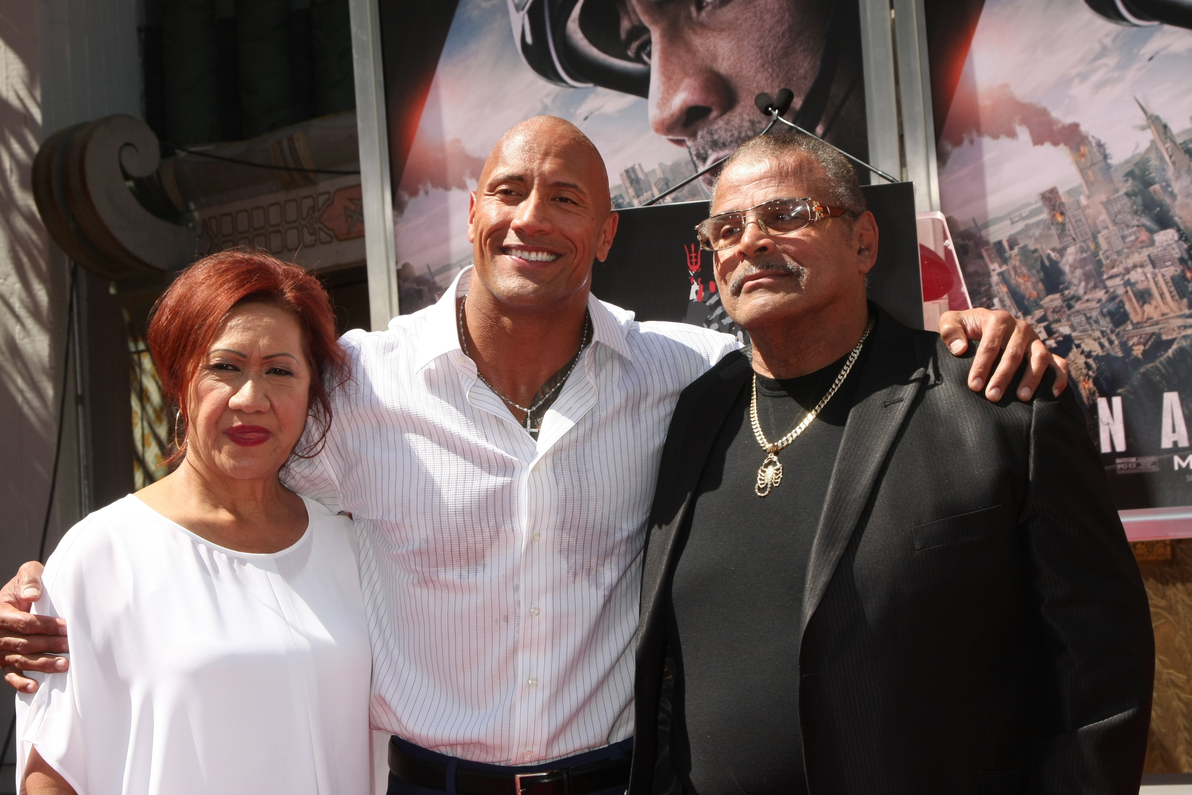 Dwayne Johnson pictured with his mom, Ata Johnson, and dad, Rocky Johnson, at his Hand and Foot Print Ceremony at the TCL Chinese Theater, 2015. California | Photo: Shutterstock