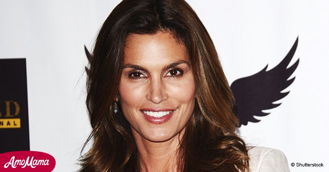 Cindy Crawford looks absolutely ageless as she shows off her toned legs in a white mini dress