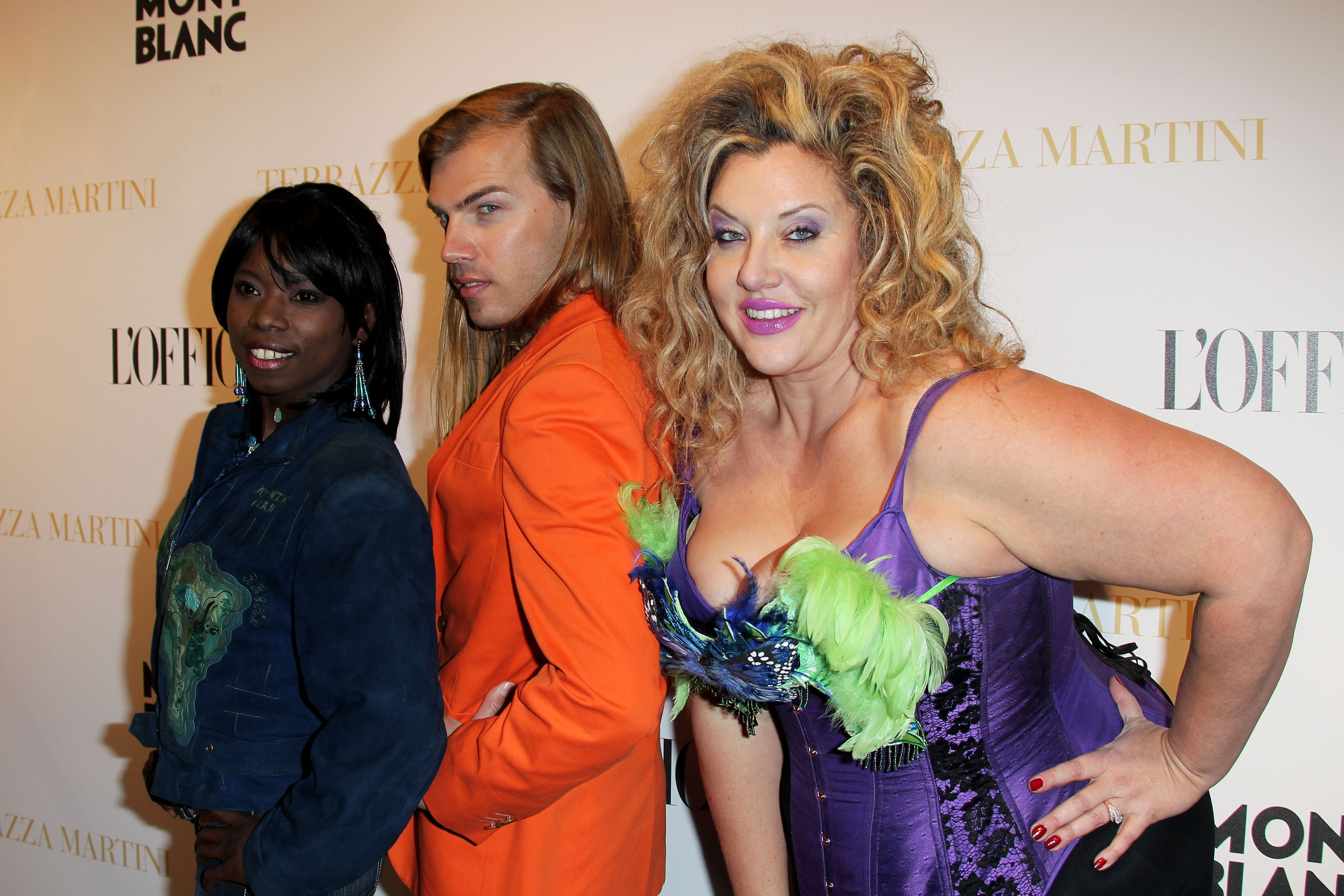 Surya Bonaly, Designer Christophe Guillarme and Model Velvet d'Amour at the Terraza Martini during the 63rd Annual International Cannes Film Festival on May 14, 2010 | Photo: Getty Images