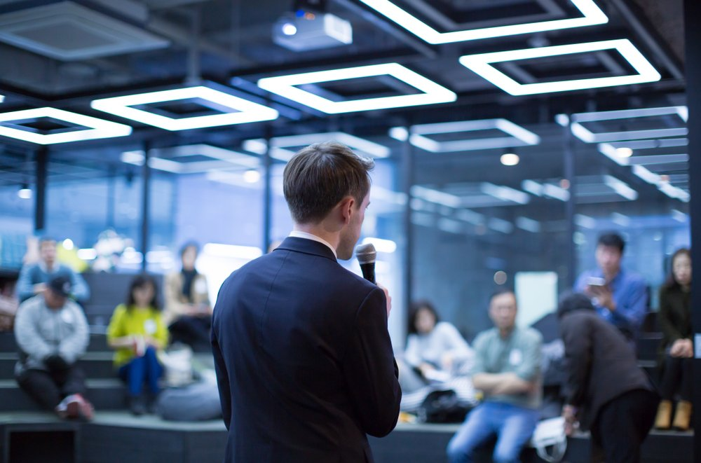A photo of a speaker addressing some people | Photo: Shutterstock