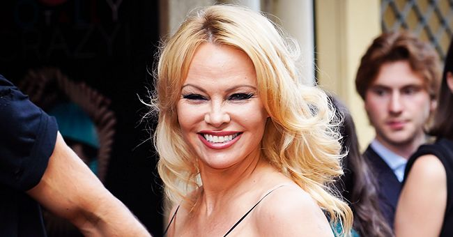 'Baywatch' Star Pamela Anderson, 53, Admits She's Lonely as She Poses in a Lacy White Dress