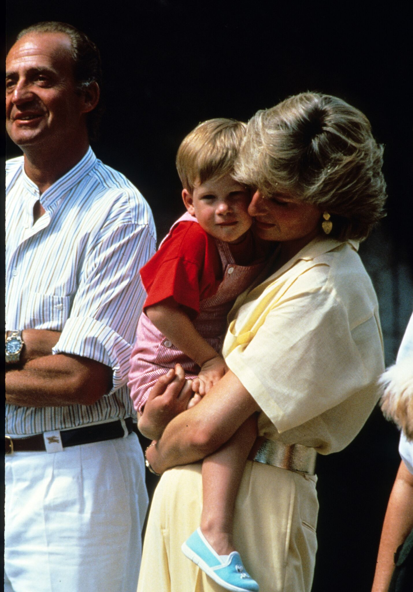 Princess Diana, Princess of Wales, holds Prince Harry whilst on holiday in Majorca, Spain on August , 1988 | Getty Images / Global Images Ukraine