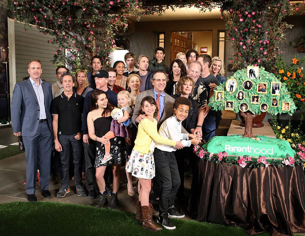 The cast of 'Parenthood' pose at NBC's 'Parenthood' 100th episode cake-cutting ceremony at Universal Studios on November 7, 2014 | Photo: Getty Images
