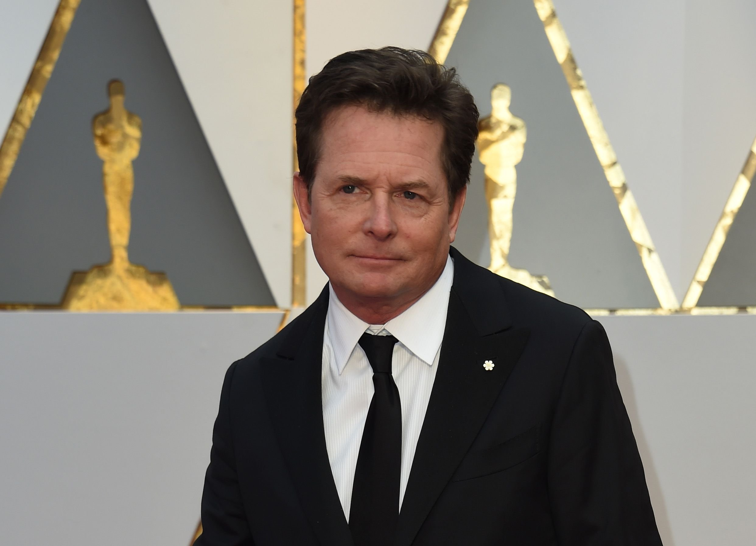 Michael J. Fox arrives on the red carpet for the 89th Oscars on February 26, 2017 in Hollywood, California. | Photo: Getty Images