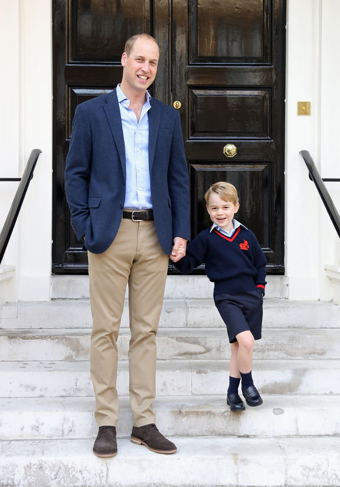 Prince George and his father Prince William pose for a photo on his first day of school at Thomas's Battersea    Source: Getty Images