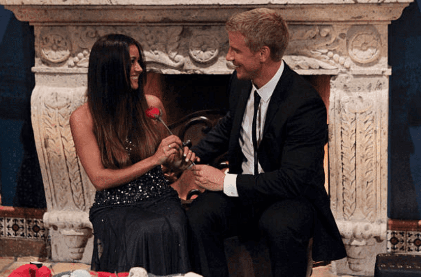 "Sean Lowe and Catherine Giudici sit in front of a fire place after he gives her a rose in season 17 of ""The Bachelor,"" on January 7 2013 