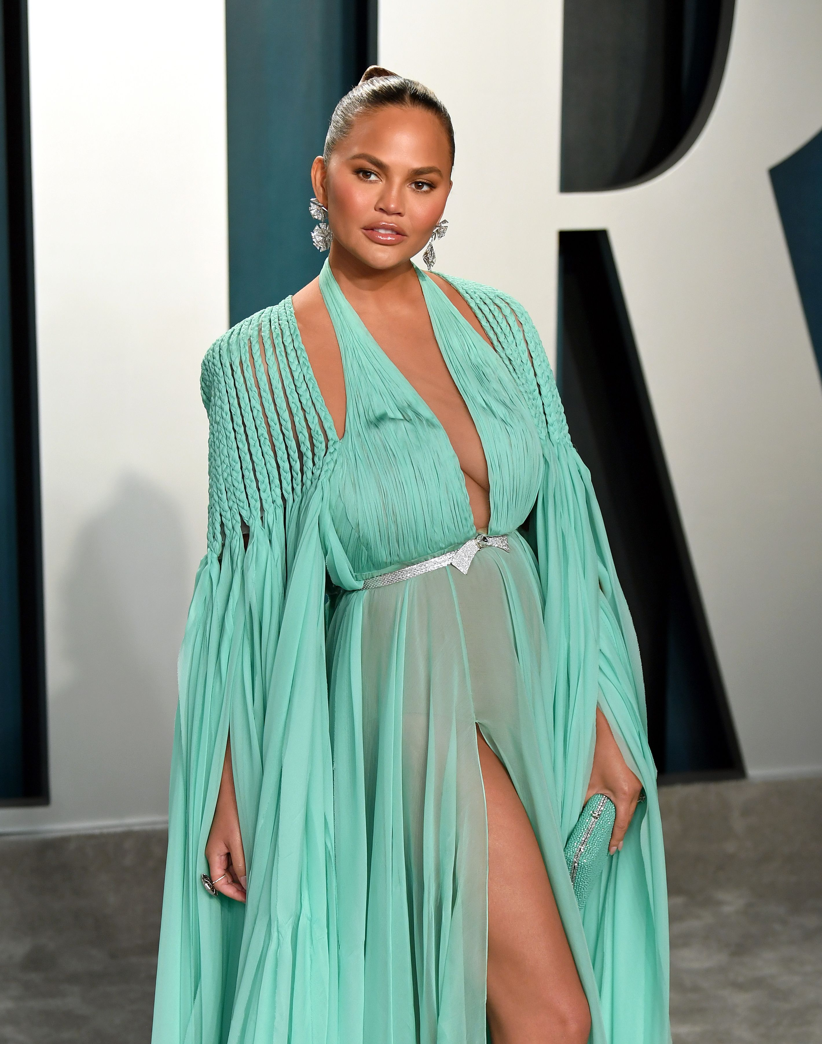 Chrissy Teigen attends the 2020 Vanity Fair Oscar Party hosted by Radhika Jones at Wallis Annenberg Center for the Performing Arts on February 09, 2020 in Beverly Hills, California. | Source: Getty Images