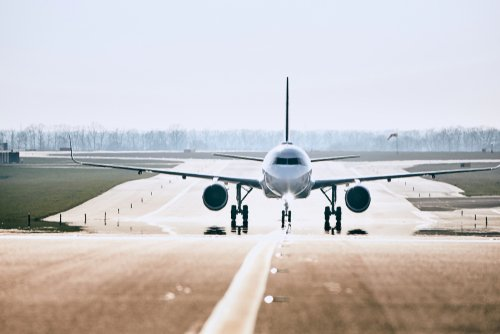 An airplane taxing on the tarmac. | Source: Shutterstock.