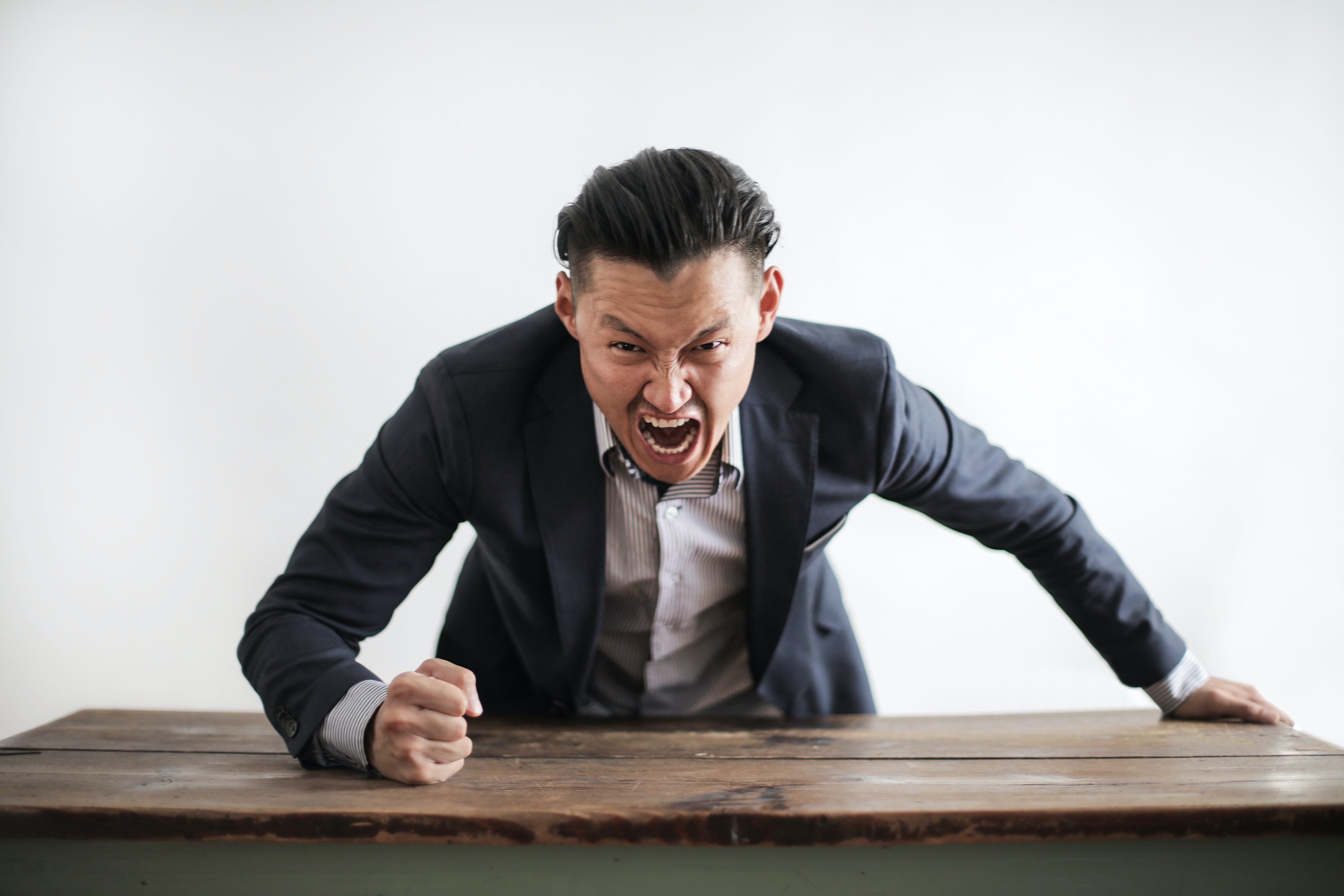 Pictured - An upset executive yelling at the camera | Source: Pexels
