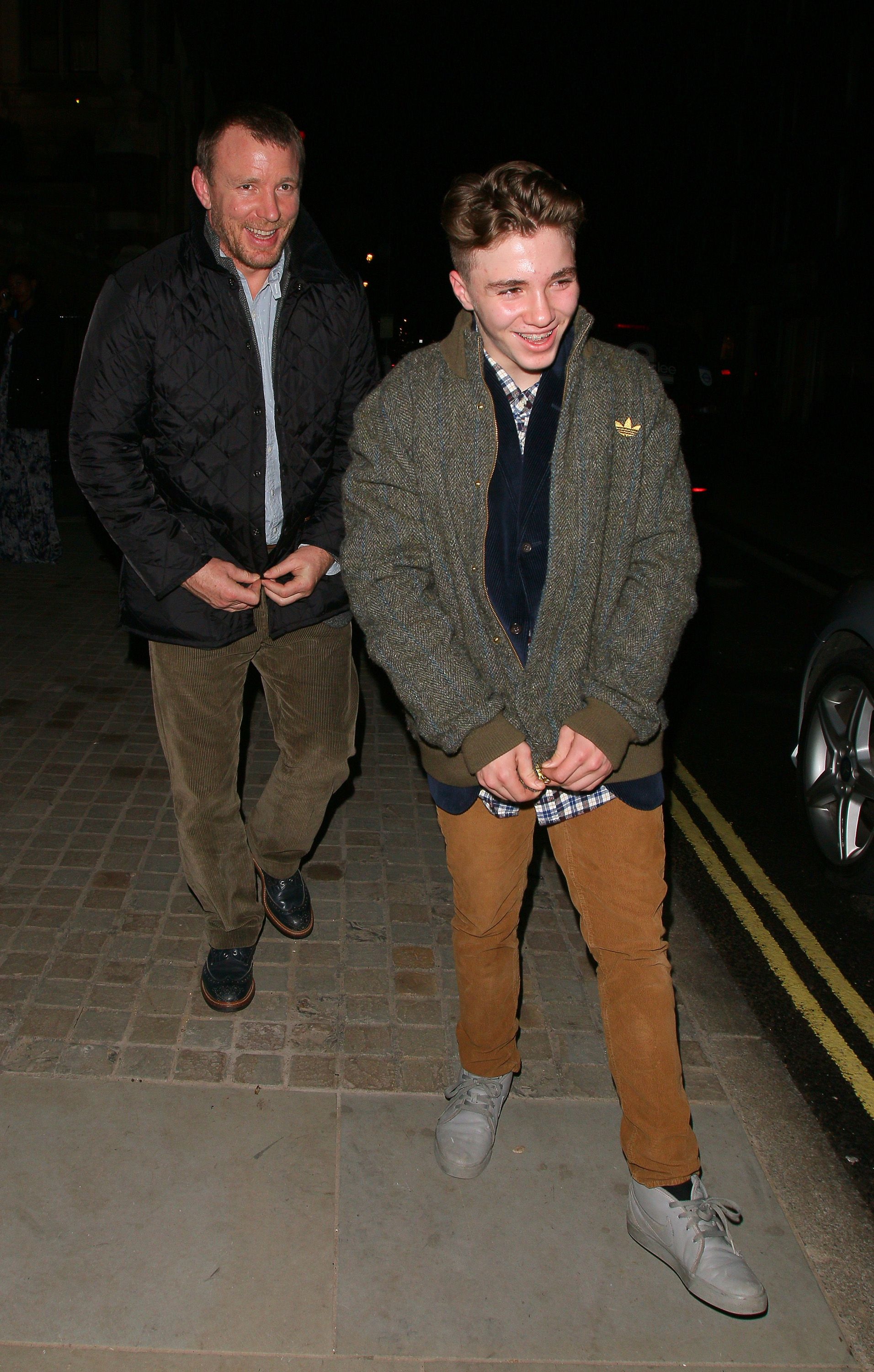 Guy Ritchie and Rocco Ritchie during London Fashion Week in February 2014 in London, England | Source: Getty Images