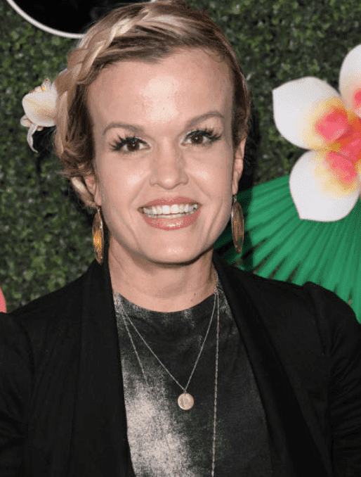 Terra Jole stand infant of a flower wall at the Lifetime's Summer Luau, on May 20, 2019, in Los Angeles, California | Source: Getty Images (Photo by Paul Archuleta/FilmMagic)