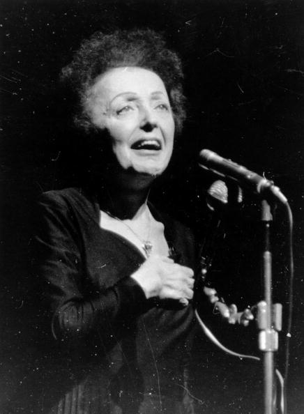 Parisian popular singer Edith Piaf (1915 - 1963), performing at the Olympia, Paris | Photo: Getty Images
