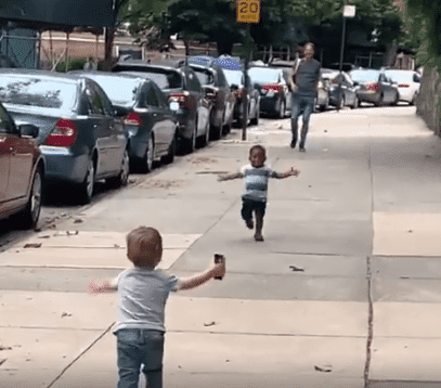 Two two-year-olds, Maxwell and Finnegan seen running to give each other a warm embrace | Photo: Facebook/MichaelDCisnerosNYC