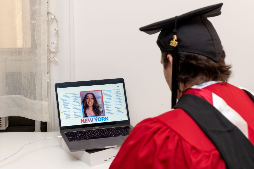 A graduate watches Cardi B from their laptop as she spoke during a virtual graduation ceremony hosted by Facebook on May 15, 2020, New York City | Source: Alexi Rosenfeld/Getty Images