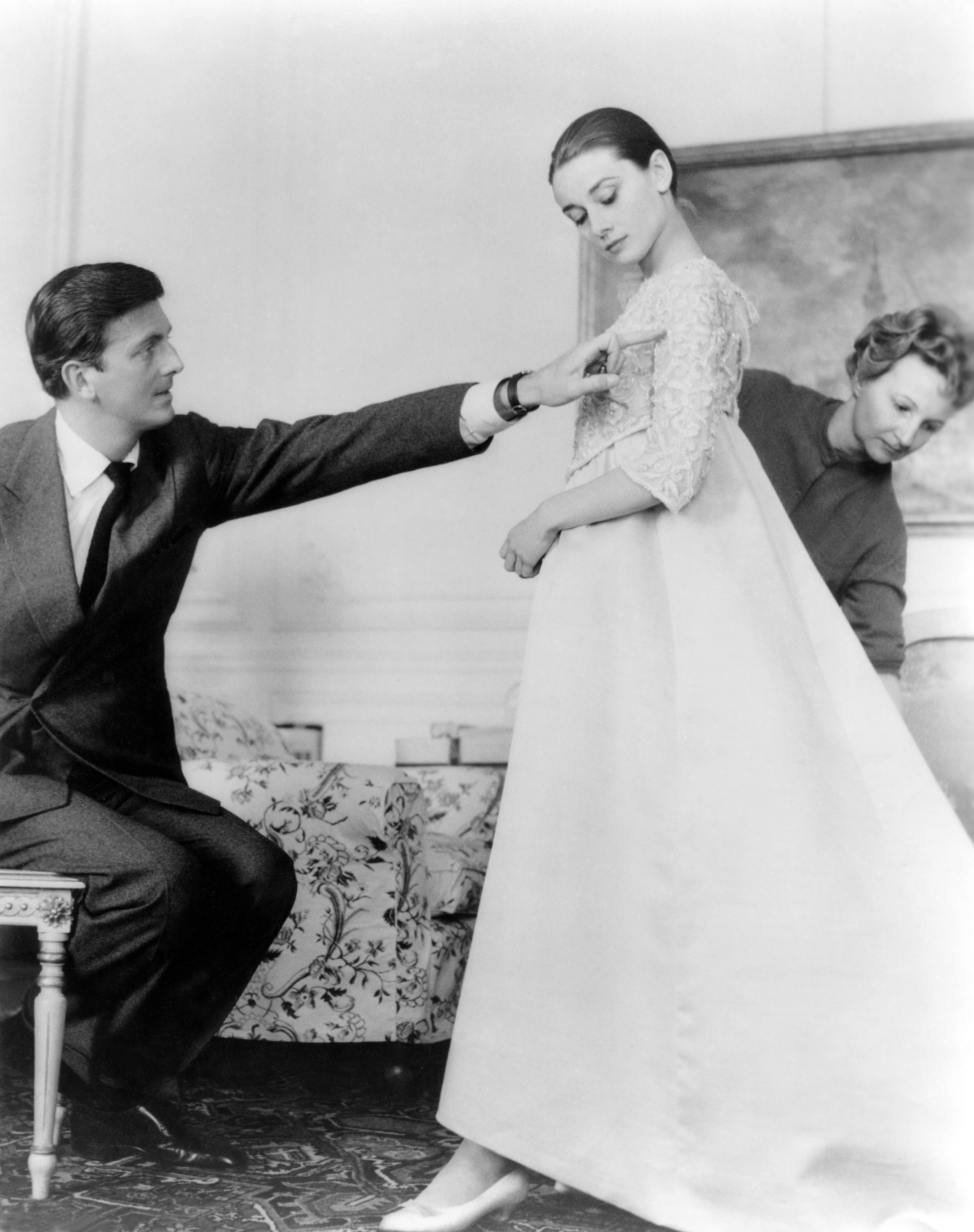 Audrey Hepburn with couturier Hubert de Givenchy in his workshop, in Paris   Source: Getty Images