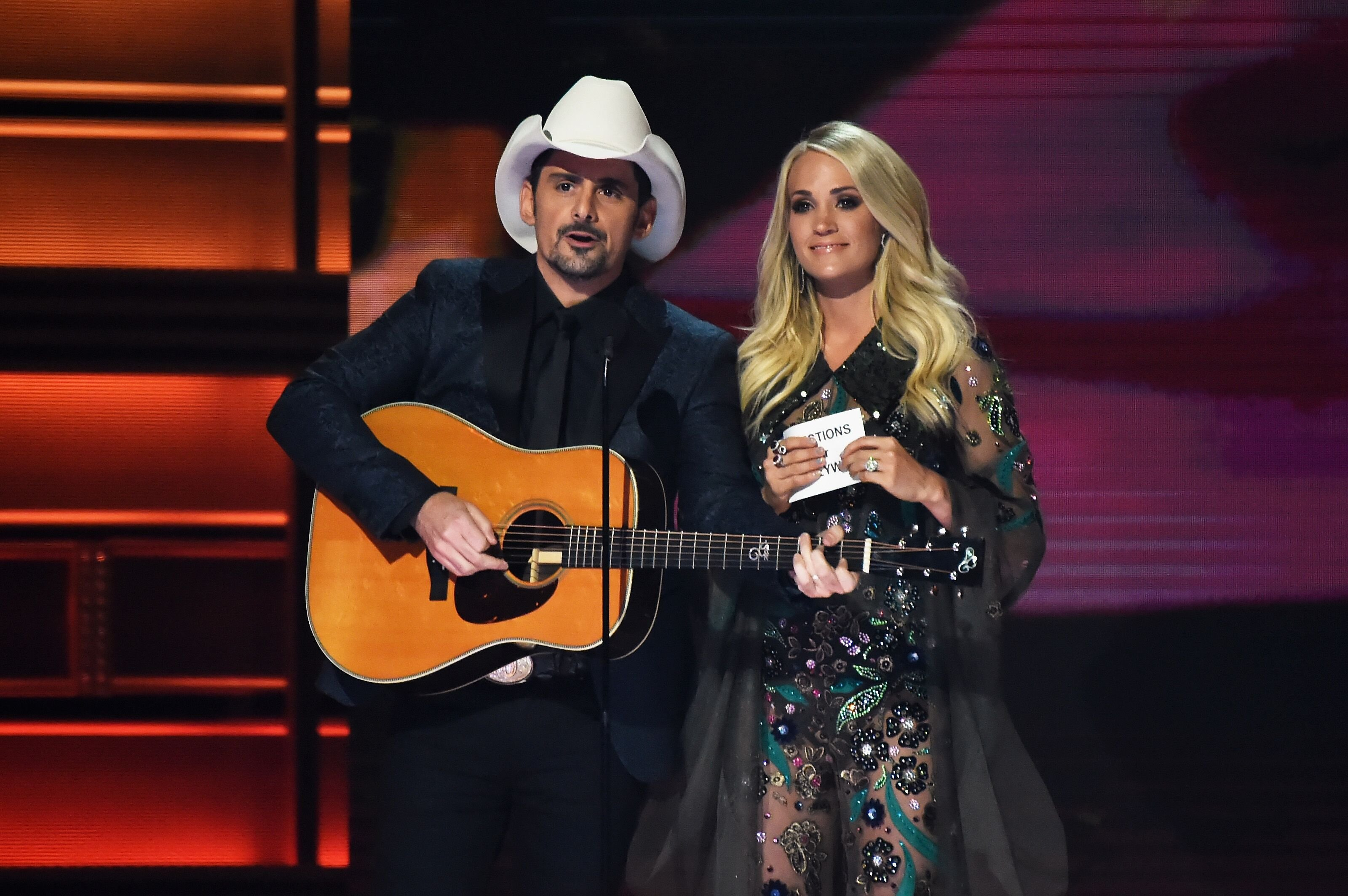 Brad Paisley and Carrie Underwood co-hosting the 51st annual CMA Awards at the Bridgestone Arena on November 8, 2017 in Nashville, Tennessee | Photo: Getty Images
