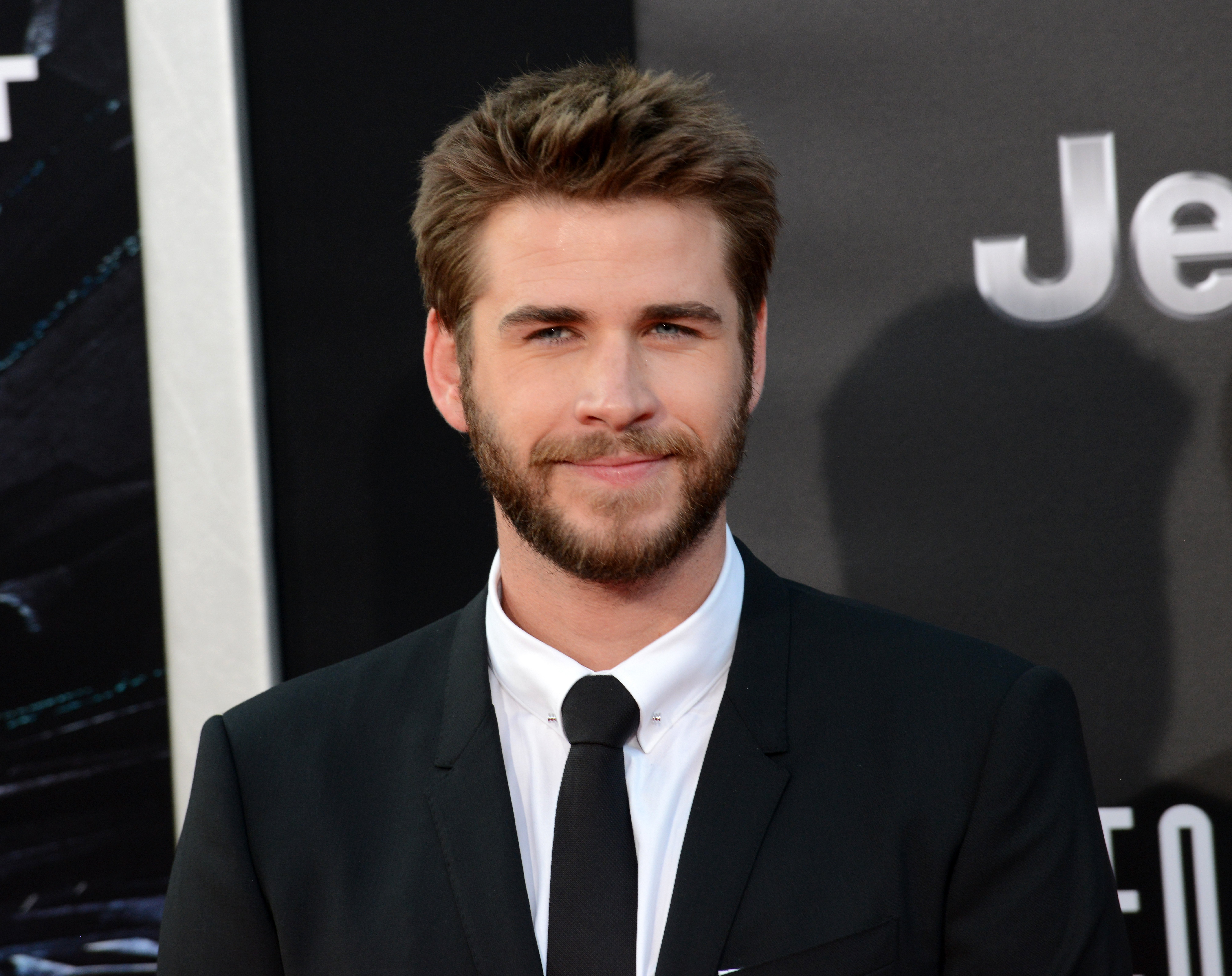 """Liam Hemsworth arrives for the Premiere Of 20th Century Fox's """"Independence Day: Resurgence"""" held at TCL Chinese Theatre on June 20, 2016, in Hollywood, California. 