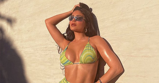Kylie Jenner Showcases Her Flawless Figure Posing in a Patterned Green Bikini & Matching Skirt