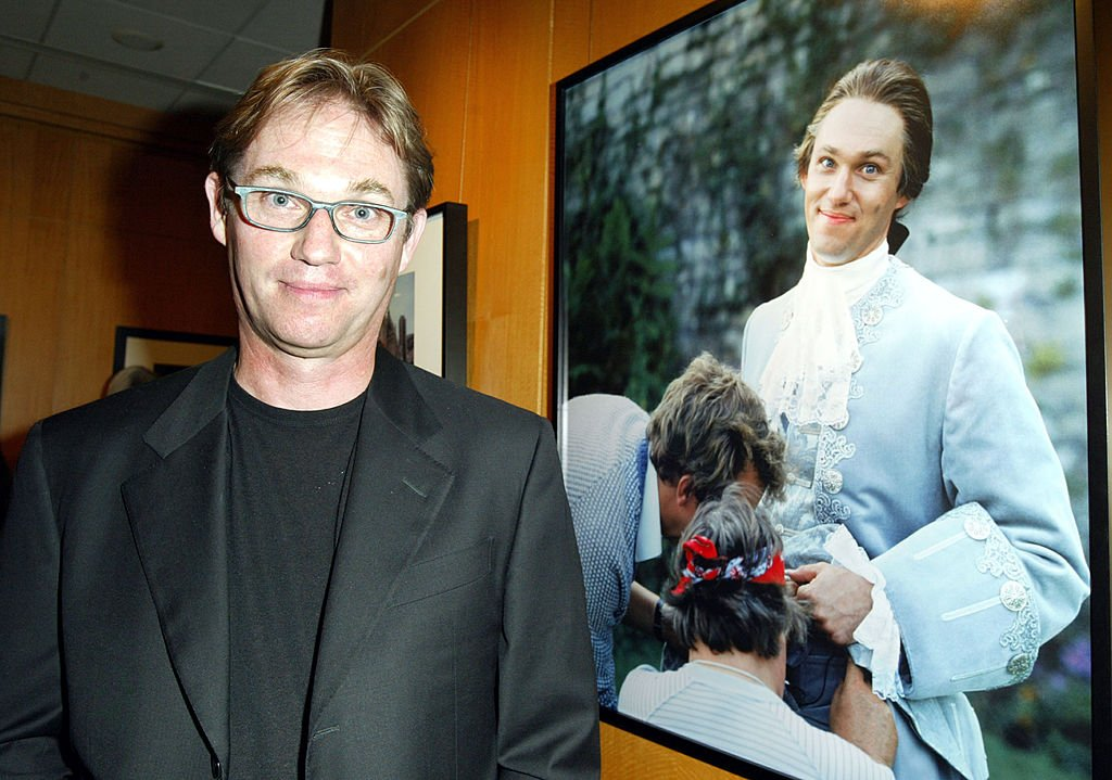 Richard Thomas poses in front of his portrait taken by photographer Pat York on September 12, 2003 in Beverly Hills, California. | Photo: Getty Images
